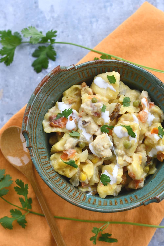 24Bite: Crock Pot Chicken and Tortellini Recipe served in a bowl by Christian Guzman