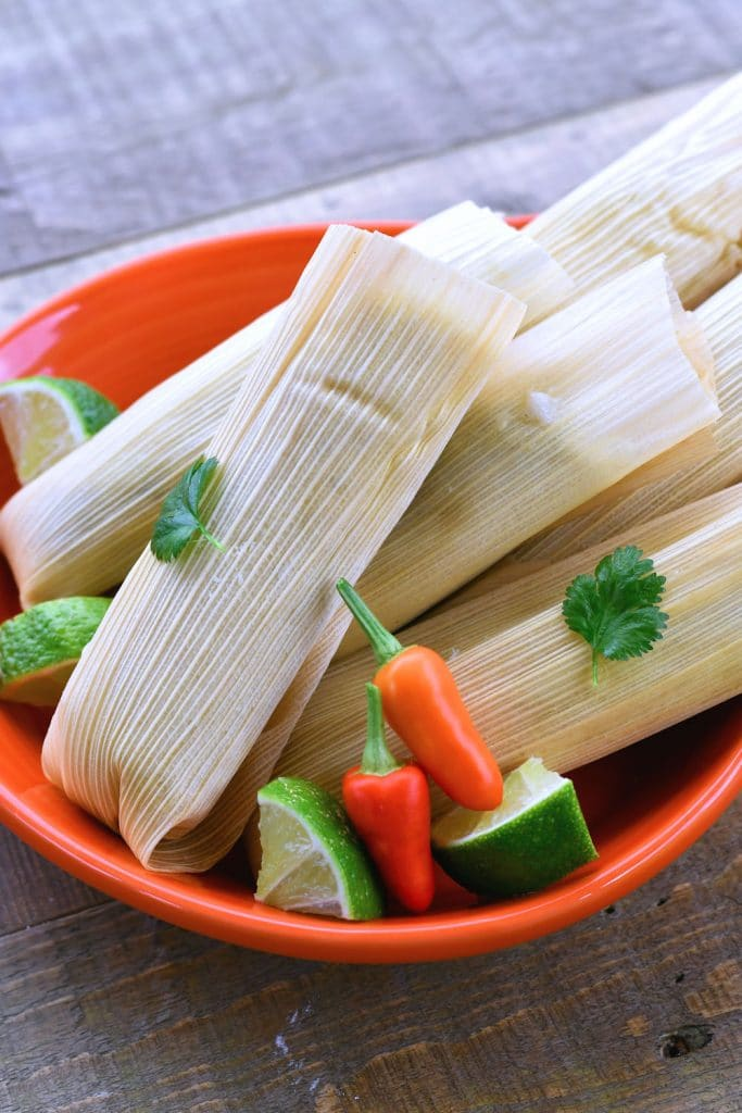 24Bite: Beautiful chicken tamales wrapped in corn husks and served with lime cilantro and Thai chiles