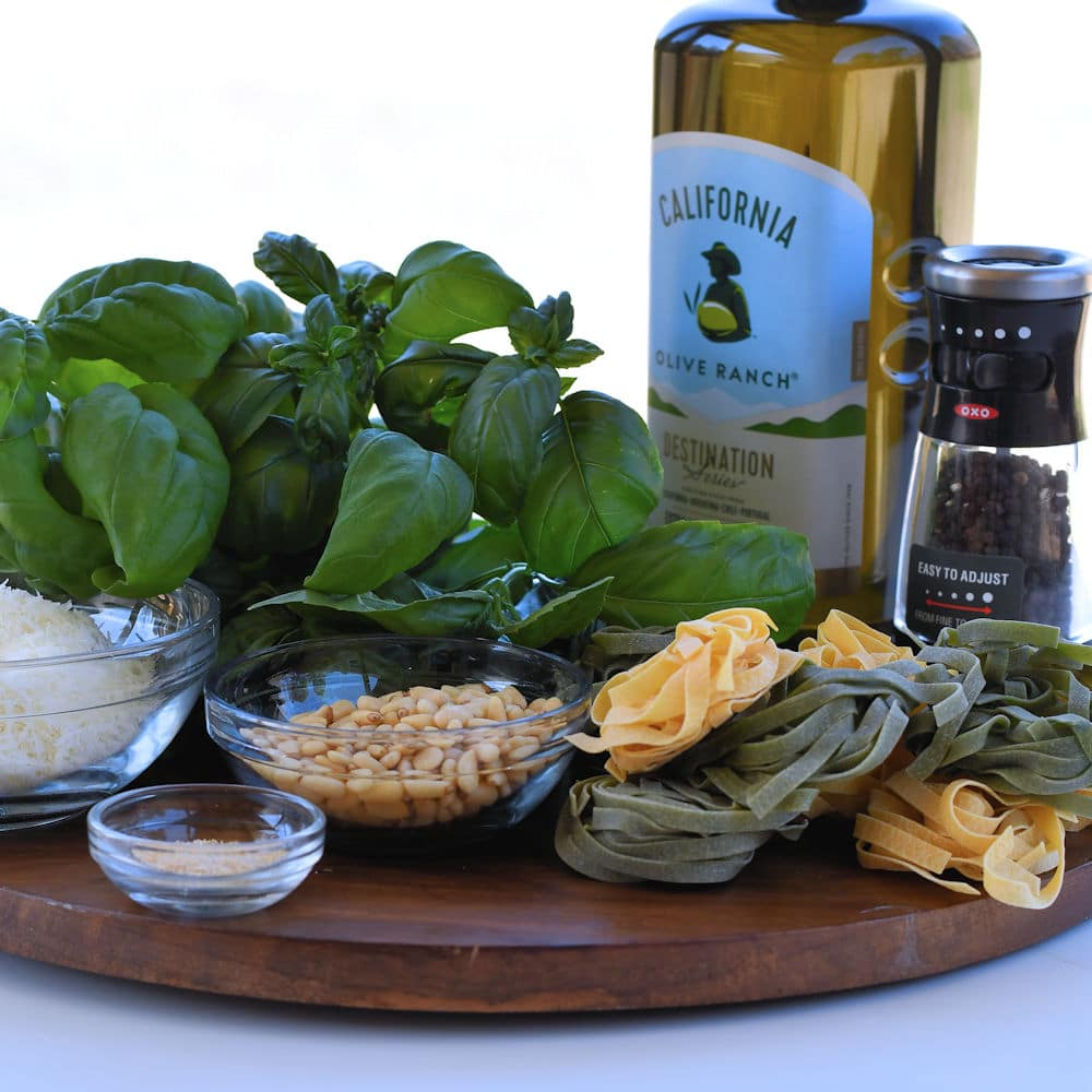 24Bite: olive oil, basil, pine nuts and pasta on wooden platter