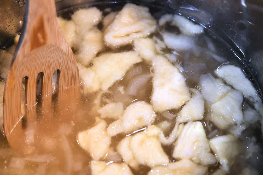 24Bite: dropping dough into chicken broth for chicken and dumplings