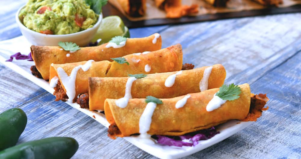 24bite: rectangle plate of baked cheeseburger rolled tacos