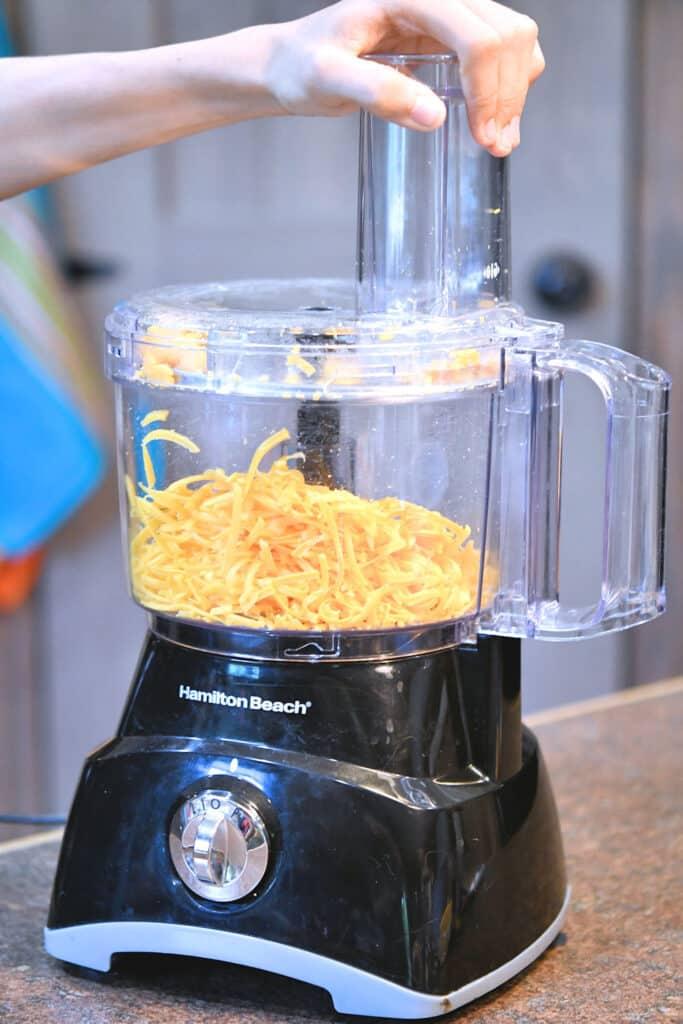 24Bite: Christian Guzman shredding cheddar cheese with a food processor