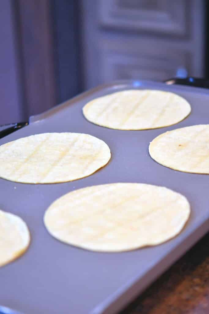 24Bite: corn tortillas cooking on an electric griddle