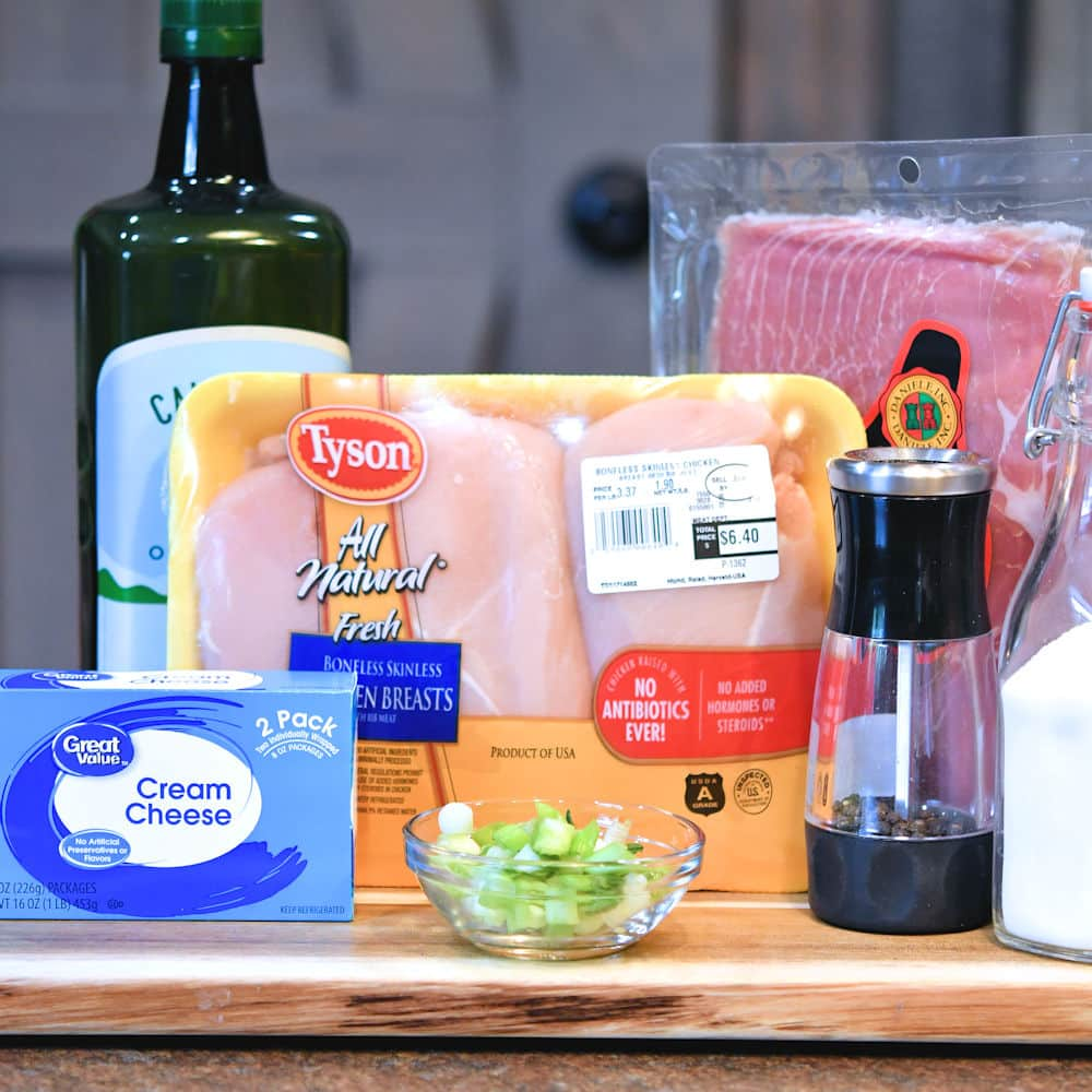 24bite: ingredients for prosciutto stuffed chicken breast displayed on cutting board