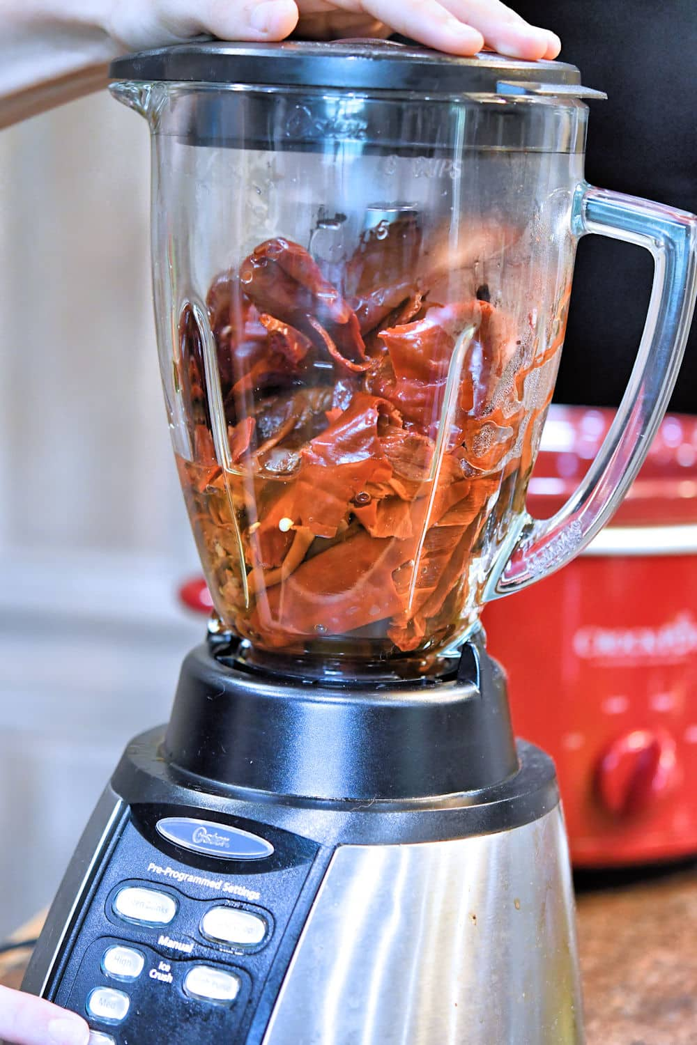 Once reconstituted, the chiles, onions and garlic are pulsed in an electric blender.