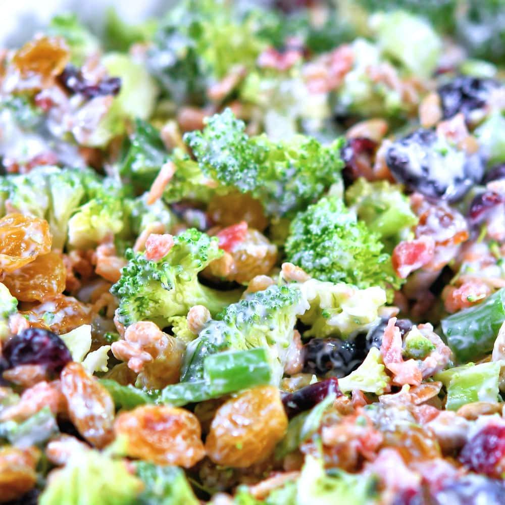 extreme closeup of creamy broccoli salad