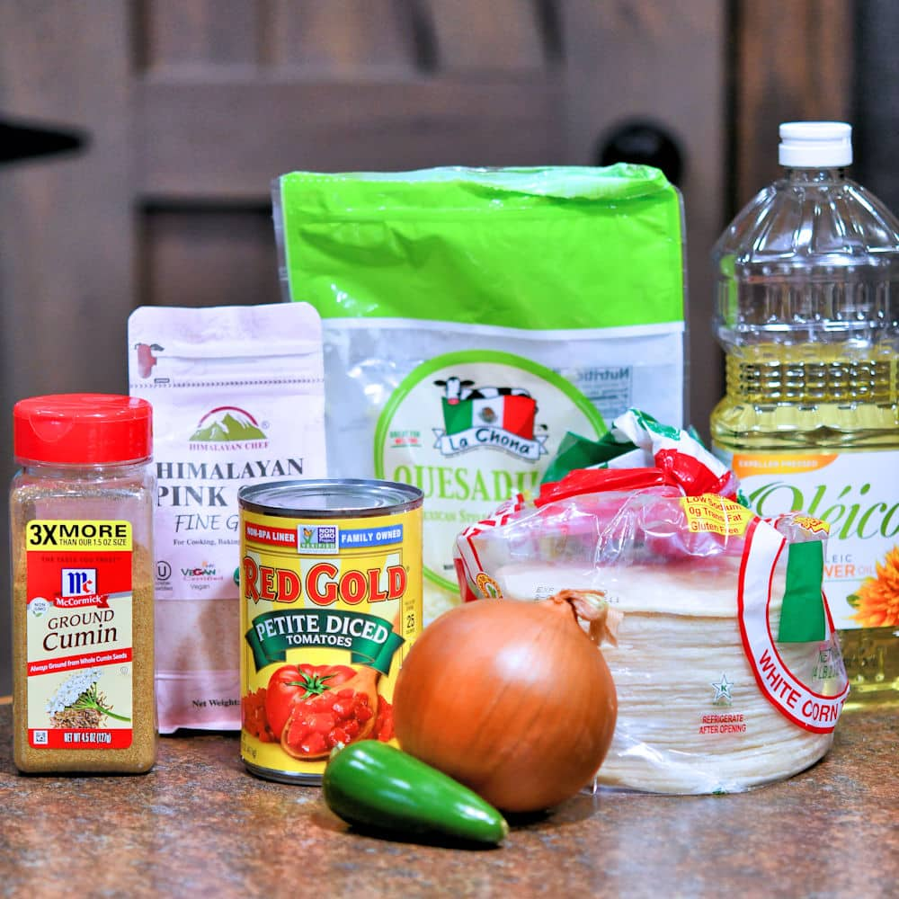 ingredients for cheese entomatadas: tortillas, onion, jalapeno, cumin, oil
