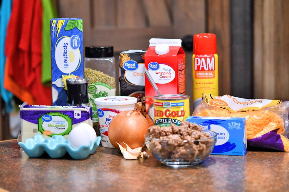 Ingredients for baked spaghetti casserole shown on a counter top, referenced in the recipe card individually