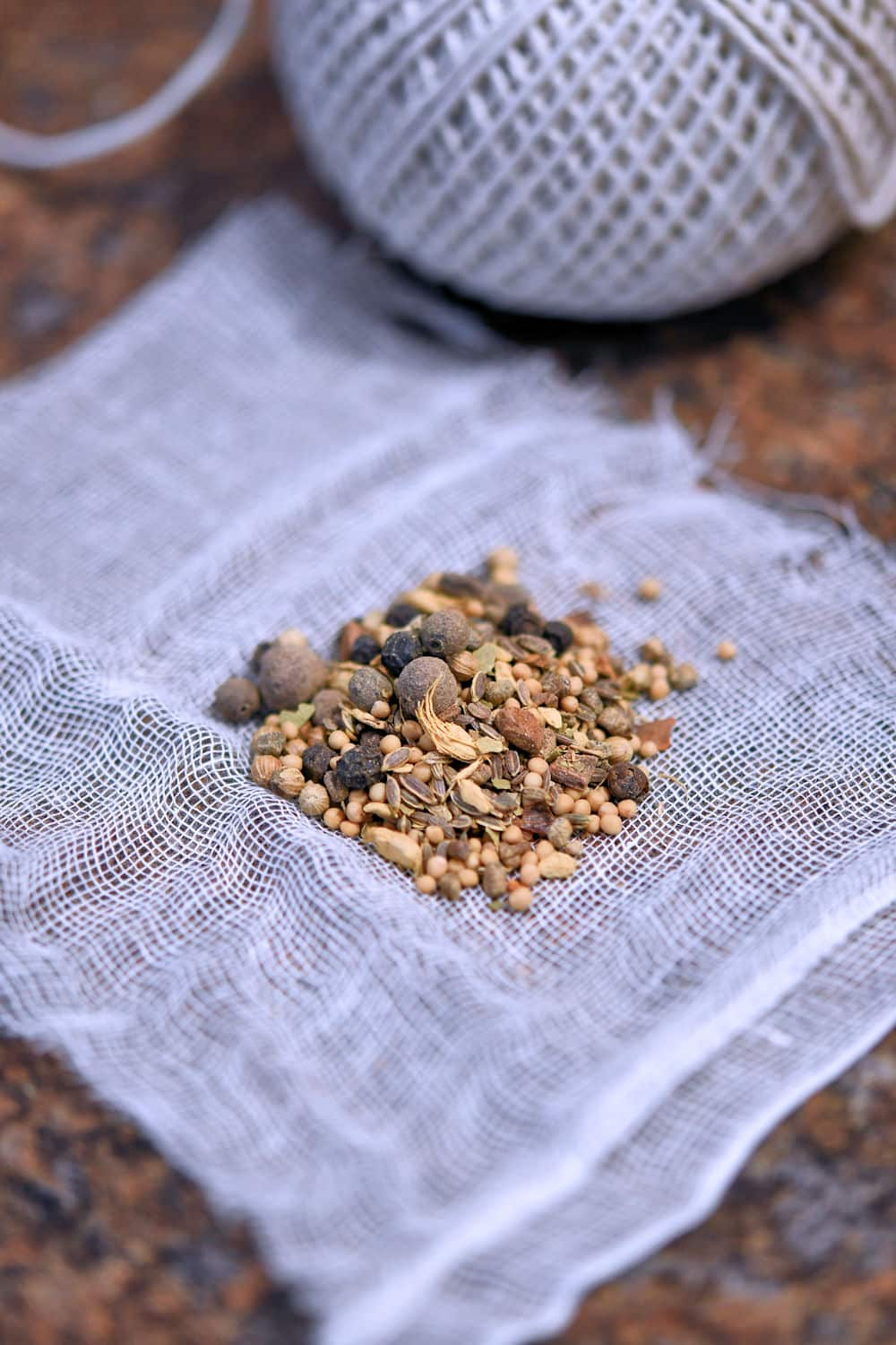 pickling spice on a small square of cheesecloth, ready to be tied and placed in saucepan