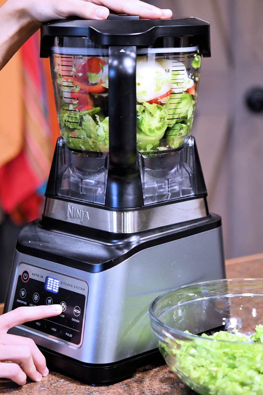 processing the raw vegetables in a food processor