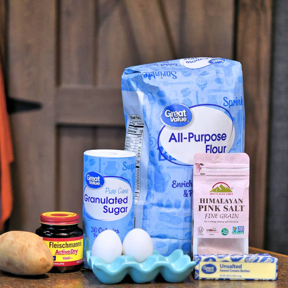 ingredients for potato dinner rolls placed on a counter top