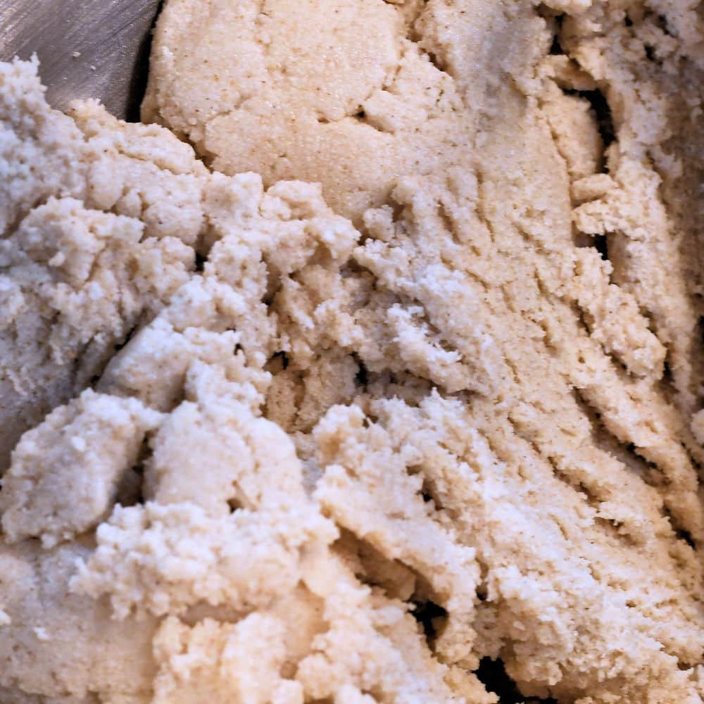 closeup image of masa harina mixed with melted lard