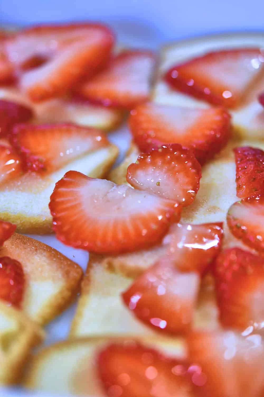 macerated strawberries layered on sliced pound cake