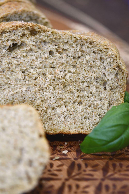 24Bite: a closeup shot of italian wheat pesto bread on a cutting board