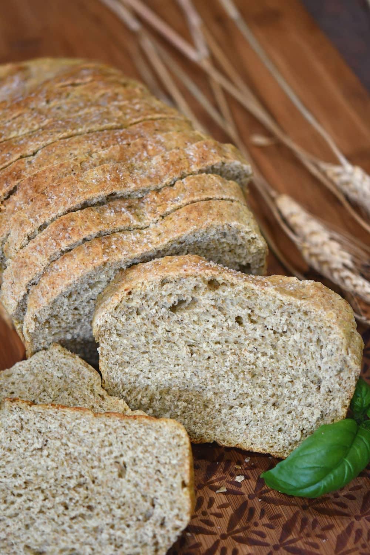 24Bite: a full sliced loaf of italian wheat pesto bread on a cutting board