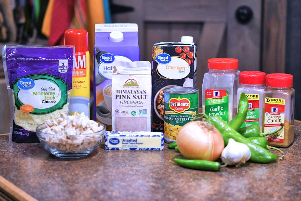 ingredients for green chile chicken soup, displayed on a counter top