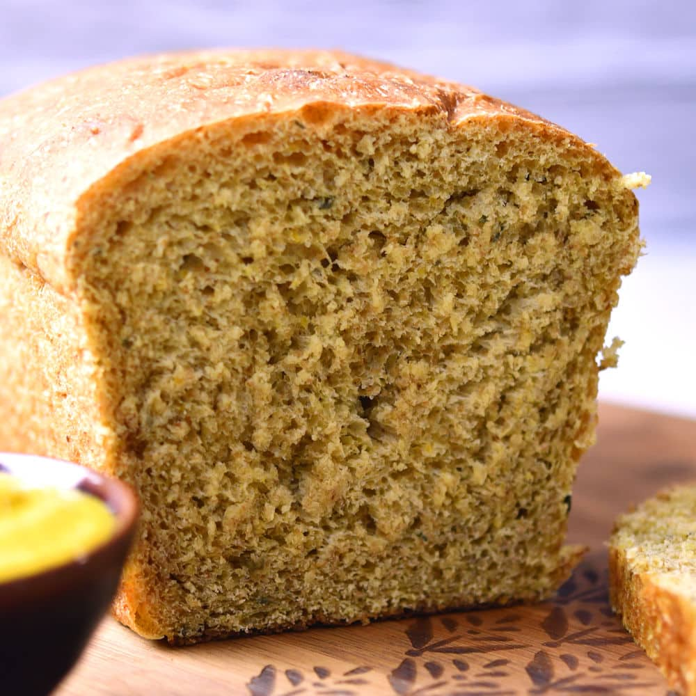 honey mustard bread, sliced with a bowl of honey mustard on the side