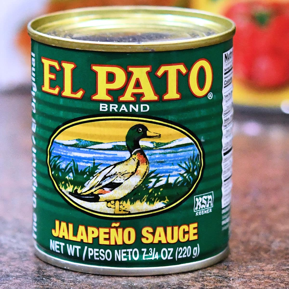 A can of El Pato Jalapeno Sauce on a countertop.