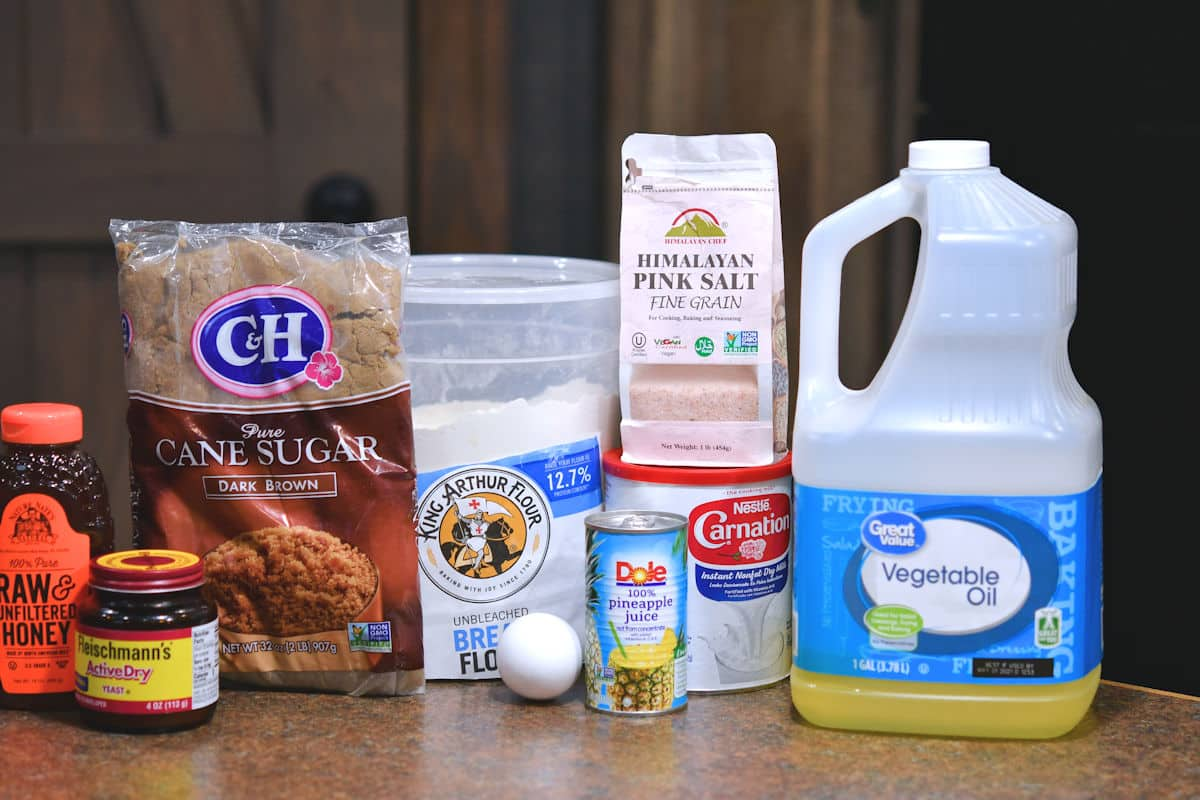 ingredients for cinnamon roll dough on a counter top