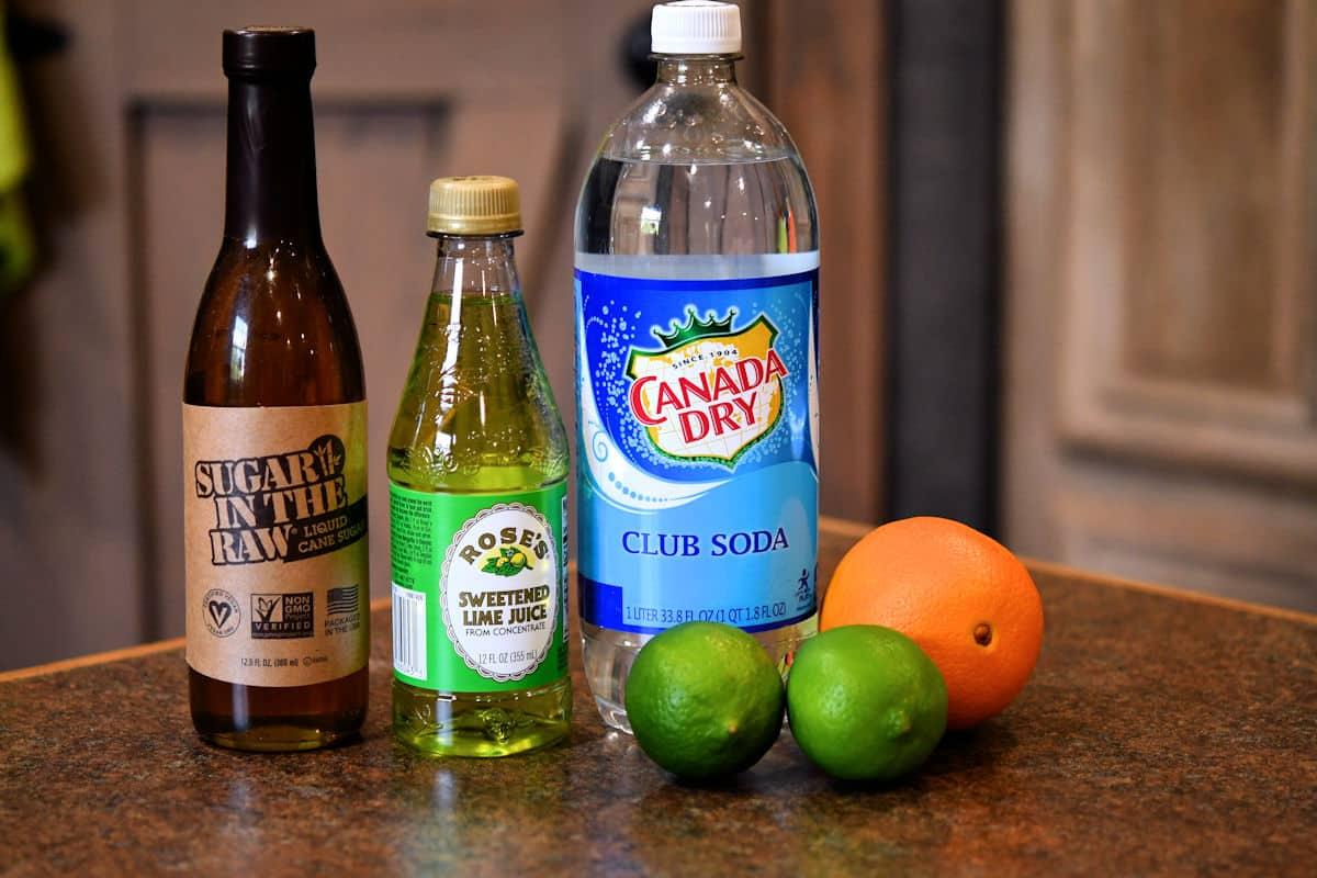 ingredients for virgin margarita mocktail displayed on a countertop