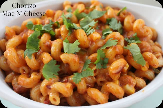 macaroni and cheese flavored with chorizo in a white bowl