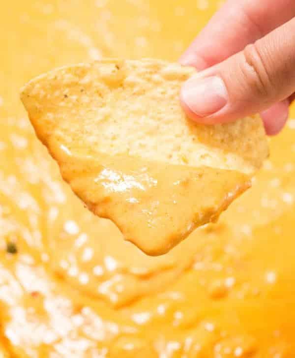 Velveeta based chorizo cheese dip on a tortilla chip