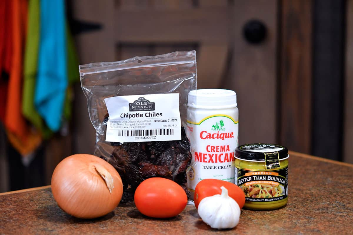 ingredients for creamy chipotle sauce on a countertop