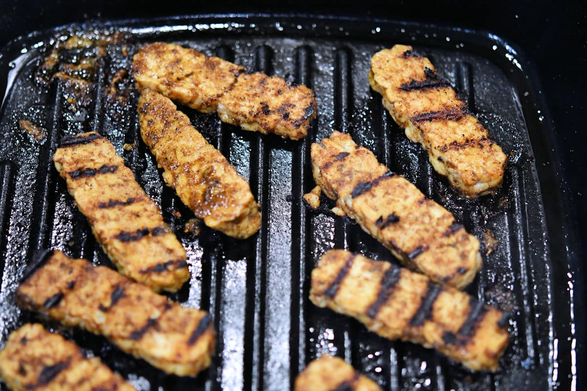 sliced tempeh in a grill pan