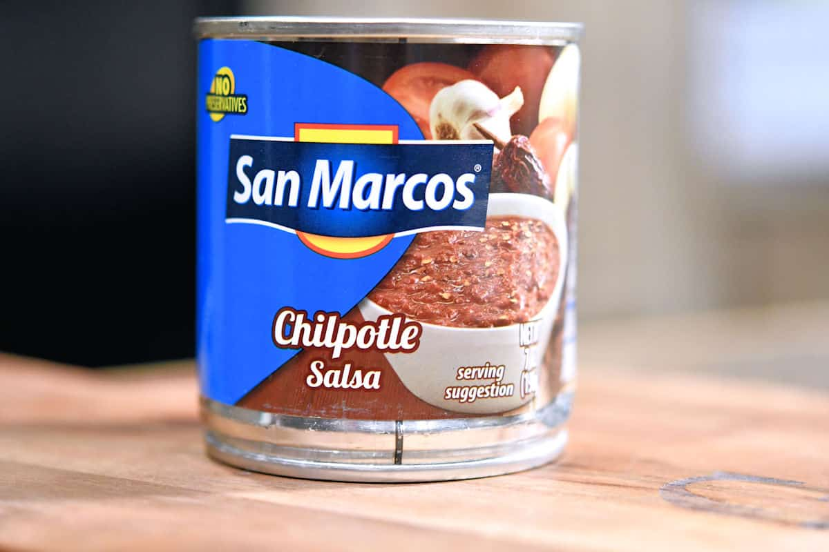 can of San Marcos Chipotle Sauce on a wooden cutting board
