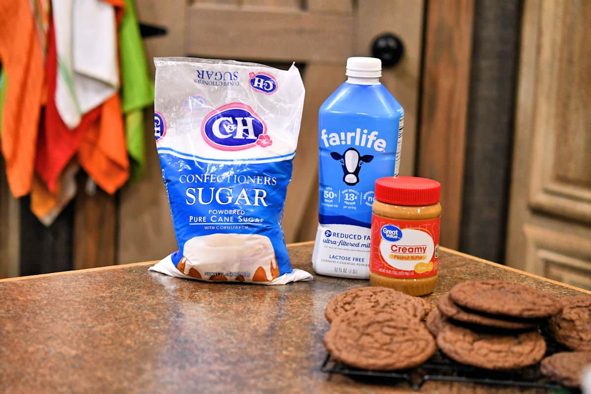 three ingredients for peanut butter frosting on a countertop