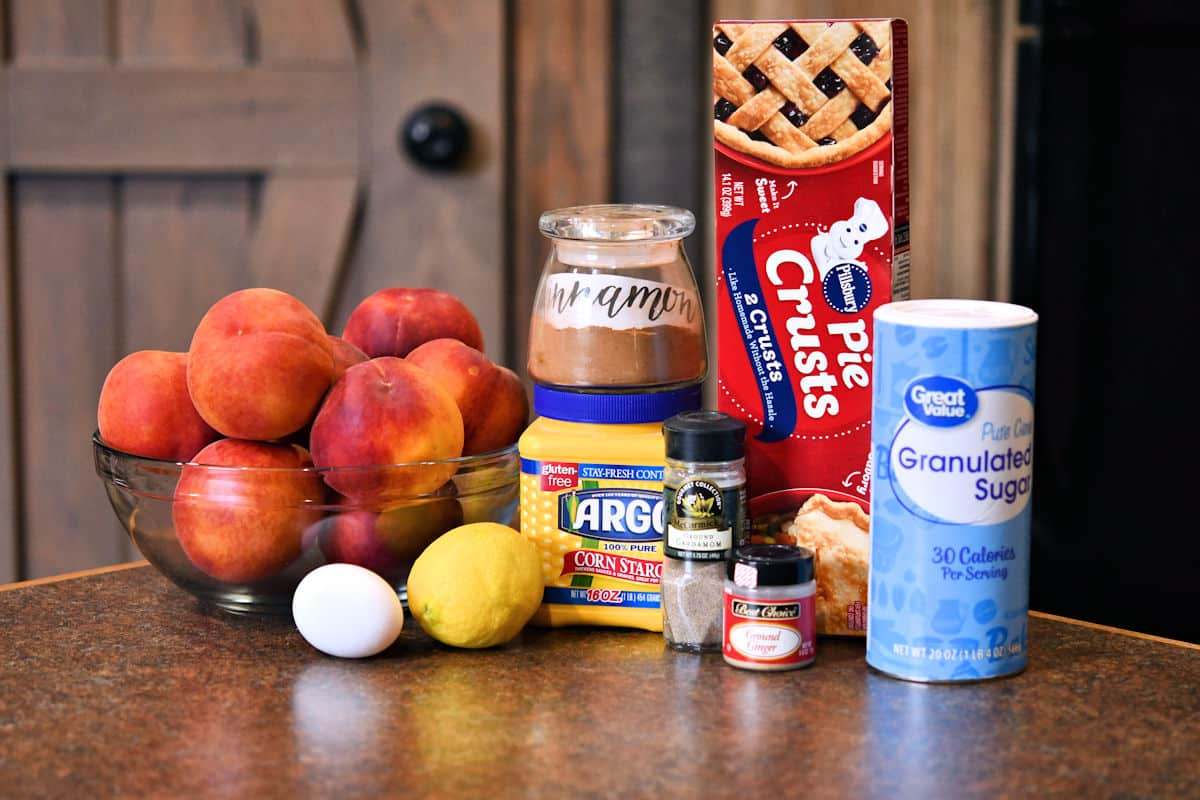 ingredients for peach pie on a kitchen countertop