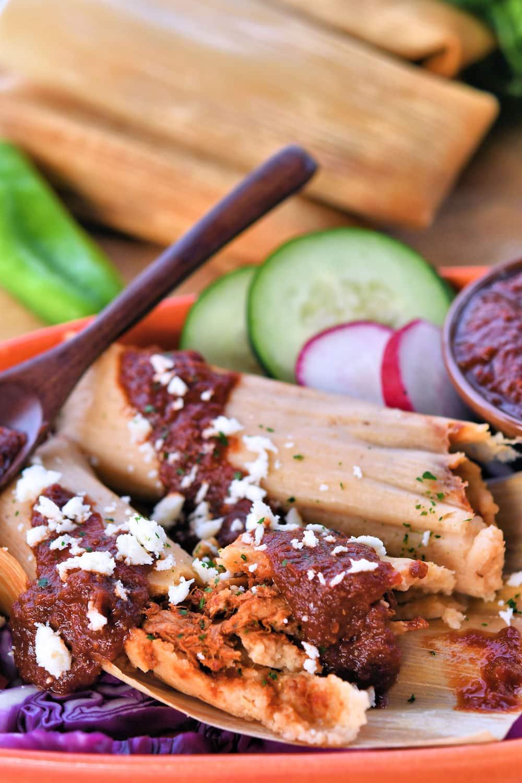 pork tamales in spicy salsa roja