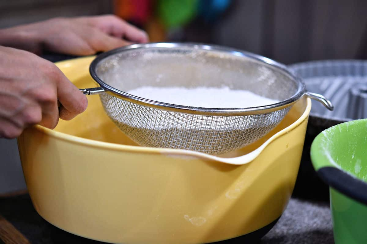 sifting flour with a fine mesh strainer