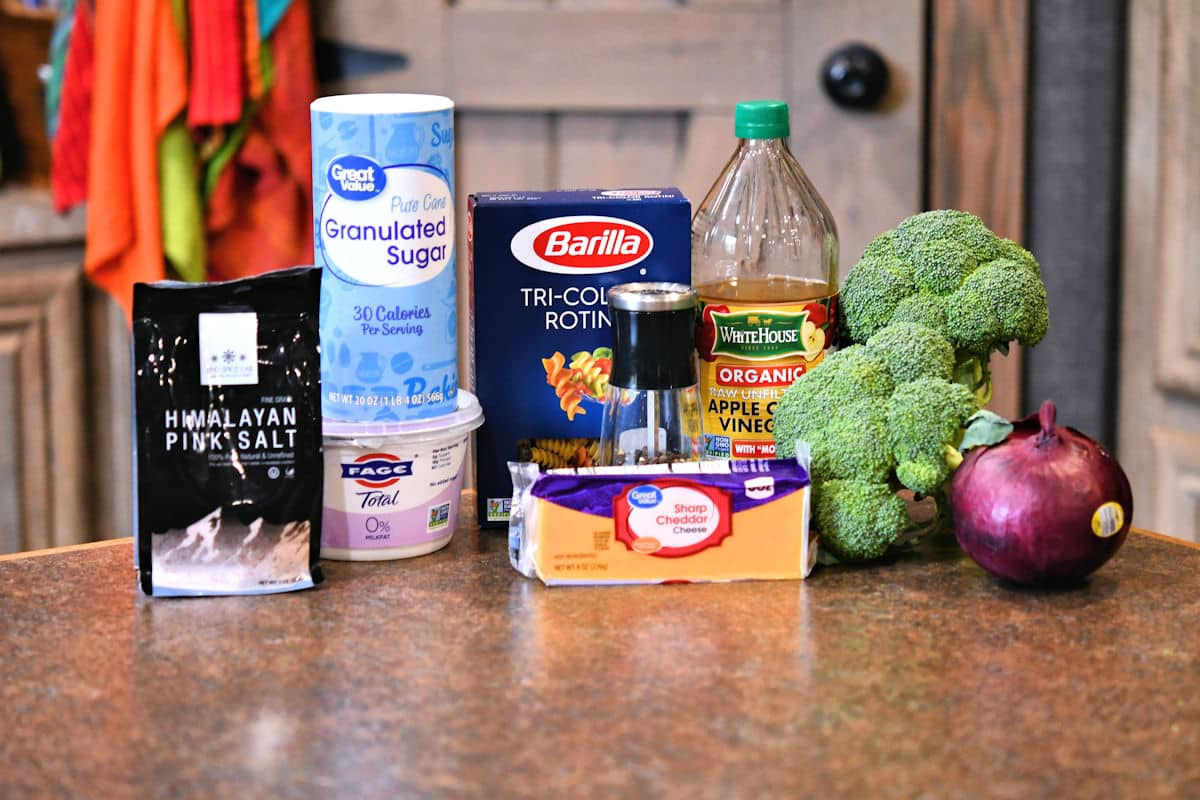 ingredients for broccoli cheddar pasta on a countertop