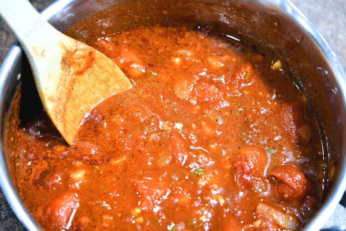tomatoes and other fragrant vegetables simmering in a saucepan