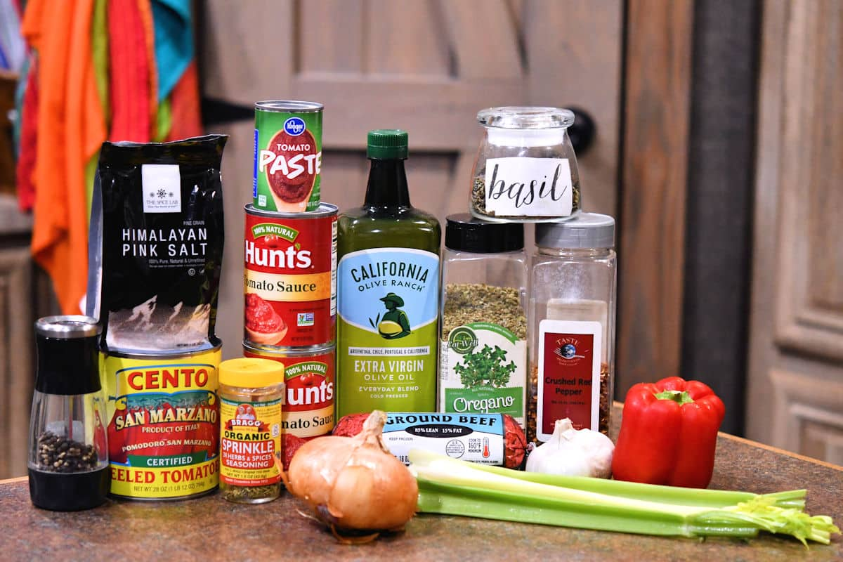 ingredients in homemade meat sauce shown in recipe on a counter