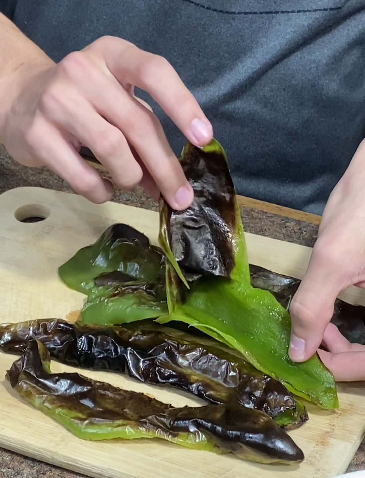 Peeling the charred skin from Anaheim peppers