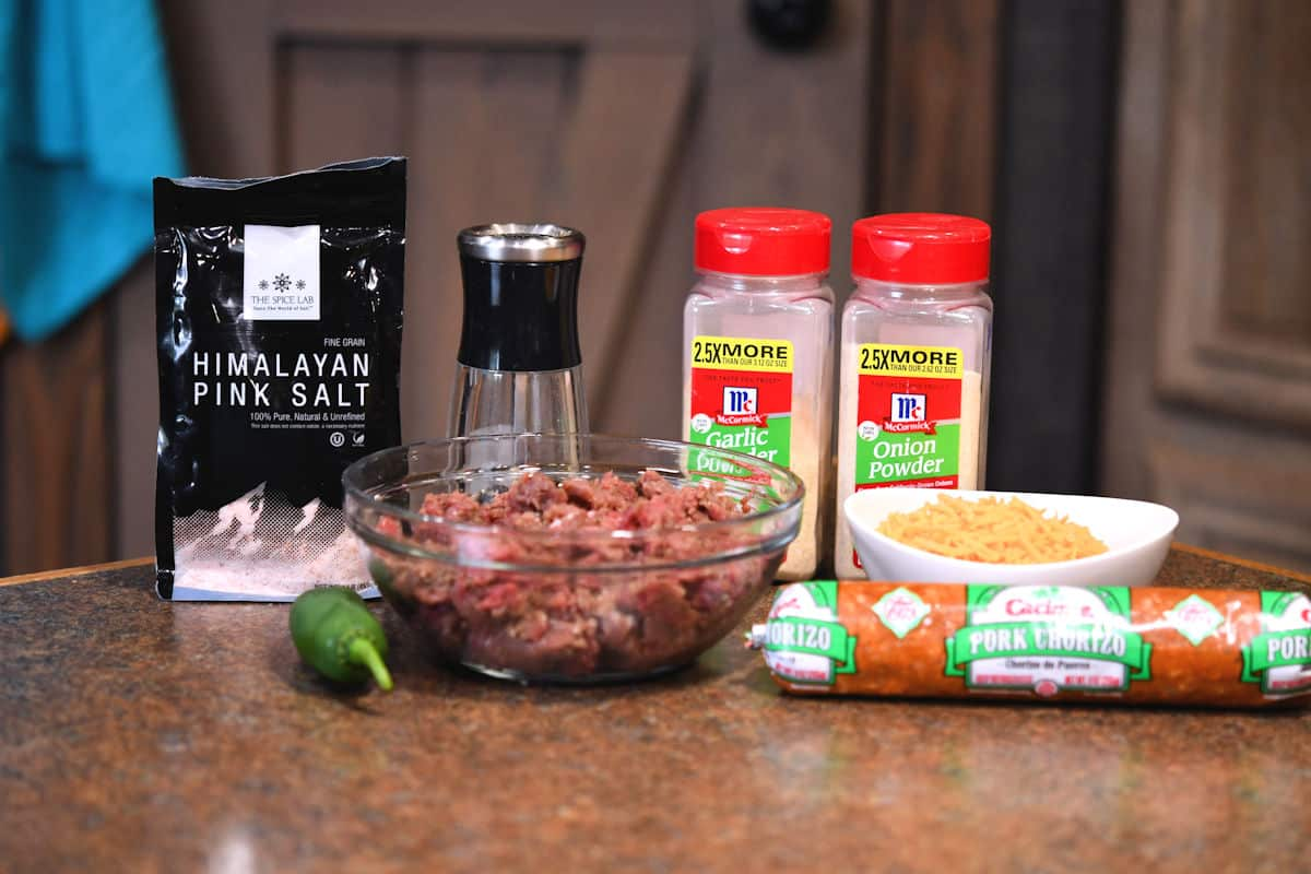 ingredients for chorizo venison burger on a countertop