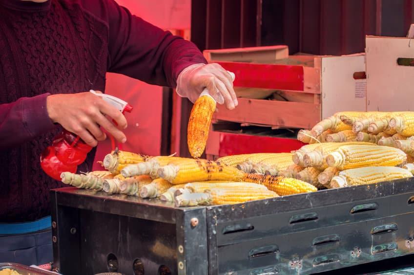 Mexican elotes on a grill, street corn vendor © jgolby via 123rf.com